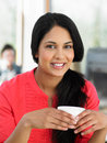Woman enjoying drink in cafe smiling to camera Royalty Free Stock Photos