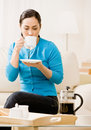Woman enjoying drinking a cup of coffee Royalty Free Stock Images