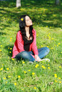 Woman enjoying flower field beautiful nice female lying down in the meadow of flowers pretty girl relaxing outdoor having fun Royalty Free Stock Images