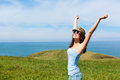 Woman enjoying freedom and travel happy funky on in asturias coast spain female on summer or spring leisure vacation raising arms Stock Images