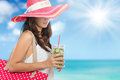 Woman enjoying fresh lime infuse water at the beach Royalty Free Stock Photo