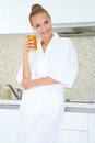 Woman enjoying fresh orange juice for breakfast Stock Photos