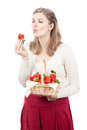 Woman enjoying fresh strawberries Stock Images