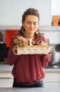 Woman enjoying freshness of mushrooms in basket young housewife Royalty Free Stock Photo