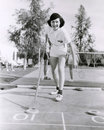 Woman enjoying a game of shuffleboard Royalty Free Stock Photo
