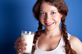 Woman enjoying a glass milk Royalty Free Stock Image