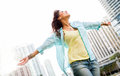 Woman enjoying her freedom beautiful urban with arms open Royalty Free Stock Image