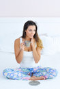 Woman enjoying her morning coffee in bed Royalty Free Stock Photo
