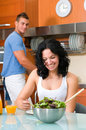 Woman enjoying her salad and man washing Royalty Free Stock Photo