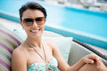 Woman enjoying her vacations by the swimming pool Royalty Free Stock Photos