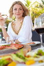 Woman enjoying meal in outdoor restaurant relaxing Stock Images