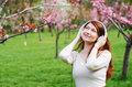 Woman enjoying music in a park Stock Photos