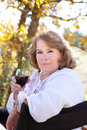 Woman enjoying red wine Royalty Free Stock Photo