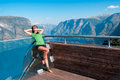 Woman enjoying scenics from stegastein viewpoint tourist on in a summer sunny day flam norway Stock Photo