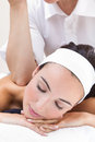 Woman enjoying shoulder massage at beauty spa pretty Royalty Free Stock Image