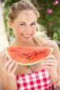 Woman Enjoying Slice Of Water Melon Royalty Free Stock Photo