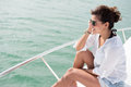 Woman enjoying the summer vacations sailing in a boat Royalty Free Stock Photos