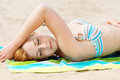Woman enjoying the sun at beach beautiful relaxed young a Royalty Free Stock Photo