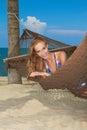 Woman enjoying a tropical getaway Royalty Free Stock Photo
