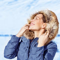 Woman enjoying winter nature closeup portrait of happy with closed eyes sun light in cold frosty day wearing fashionable Stock Images