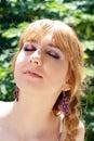 Woman enjoys sun beams Royalty Free Stock Photo