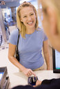 Woman entering security details for credit card pu Royalty Free Stock Photo