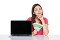 Woman with euro cash showing blank laptop screen Royalty Free Stock Photo