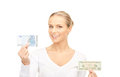 Woman with euro and dollar money notes picture of Stock Photos