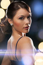Woman in evening dress wearing diamond earrings luxury vip nightlife party concept beautiful Stock Photo
