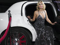 Woman in evening wear getting out of limousine beautiful young Royalty Free Stock Photos