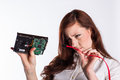 Woman examines hard drive connector a red haired female it professional the connections between a and its cable Royalty Free Stock Photography