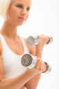 Woman exercise dumbbells white fitness close-up Stock Image