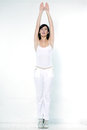 Woman exercising aerobics stretching arms tiptoe beautiful young on studio isolated white background doing her workout stretch Stock Photos