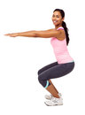 Woman exercising against white background side view portrait of confident young and doing squats vertical shot Royalty Free Stock Photography