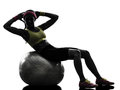 Woman exercising crunches fitness ball workout silhouette one on in on white background Stock Photo