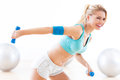 Woman exercising with dumbbells in gym Stock Photo