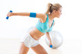 Woman exercising with dumbbells in gym Stock Photos