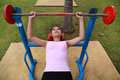 Woman exercising with exercise equipment in the park Stock Image