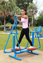 Woman exercising with exercise equipment in the park public Royalty Free Stock Photos