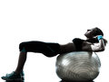 Woman exercising fitness ball workout one caucasian posture in silhouette studio isolated on white background Royalty Free Stock Images