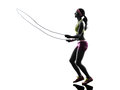 Woman exercising fitness jumping rope silhouette one caucasian in on white background Stock Photography