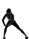 Woman exercising fitness stretching warm up silhouette Stock Photo