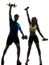 Woman exercising fitness workout with man coach one women men in silhouette on white background Stock Photography