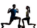Woman exercising fitness workout with man coach one women men in silhouette on white background Stock Photo
