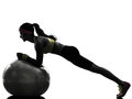 Woman exercising fitness workout plank position silhouette one on ball in on white background Royalty Free Stock Photo