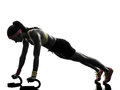 Woman exercising fitness workout push ups silhouette one in on white background Stock Image