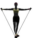 Woman exercising fitness workout resistance bands one in silhouette on white background Stock Photos