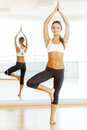 Woman exercising full length of beautiful young training in aerobics class Stock Photos