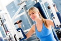 Woman exercising at the gym Royalty Free Stock Photos