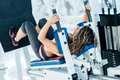 Woman exercising at the gym beautiful on a machine Royalty Free Stock Image
